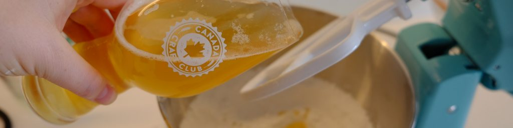 Adding craft beer from a Canada Craft Club subscription box to the dry ingredients of our beer bread recipe.